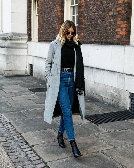 a winter look with a black sweater, blue cropped skinnies, black boots and a grey coat plus a black scarf