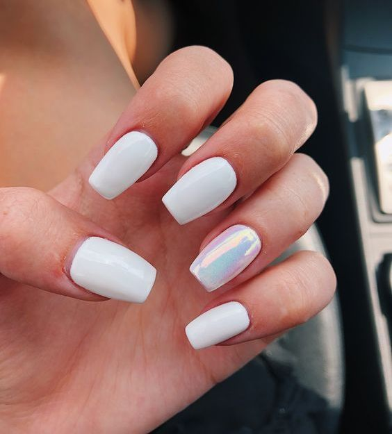 a glossy white manicure with a single iridiscent accent nail is a stylish modern idea