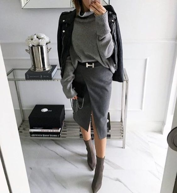 a gorgeous look with a grey sweater, a grey wrap pencil skirt, sock boots and a black leather jacket