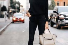 06 a total black look with a turtleneck, cropped skinnies, sock boots, a neutral bag