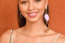 06 mismatched statement earrings in gold featuring a large pink stone in one of them