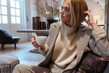 07 a black and white printed suit, a white turtleneck and glasses for a chic and stylish winter outfit