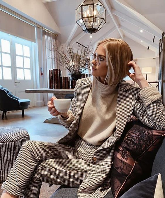 a black and white printed suit, a white turtleneck and glasses for a chic and stylish winter outfit