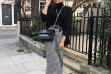 07 a chic outfit with a black turtleneck, an oversized blazer, a printed midi skirt, black boots and a bag