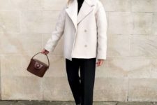07 a monochromatic look with a black turtleneck, black trousers, black hiking boots, a white coat and a brown bucket bag