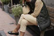 07 a neutral outfit with a black sporty padded jacket with no sleeves looks fresh and modern