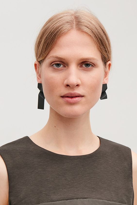 asymmetrical black geometric earrings will make a bold minimalist statement in your outfit