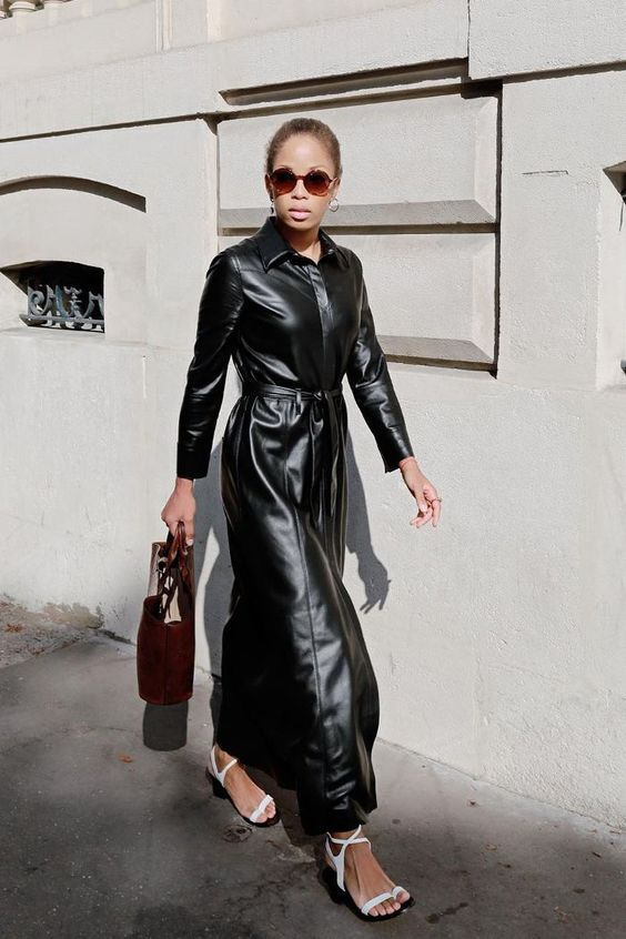 a black leather maxi dress with a belt, white strappy shoes and a burgundy bag for an edgy look