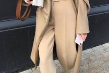 08 a camel minimalist suit with an oversized blazer, a neutral top and a sweater on top plus a cognac bag