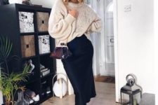 08 a chic wintry outfit with an oversized white sweater, a navy satin midi, snakeskin boots and a burgundy bag