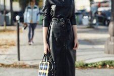 09 a black leather maxi dress with pockets and buttons, with long sleeves, whimsy shoes and a plaid bag
