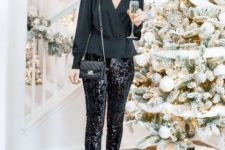 09 a black peplum top with a V-neckline, black sequin pants, black booties and a small crossbody bag
