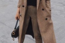09 a chic look with a black turtleneck, tan pants, a printed midi coat, white trainers and a black bag