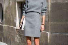 09 a monochromatic grey outfit with a turtleneck sweater, a structural mini skirt and shoes plus a clutch