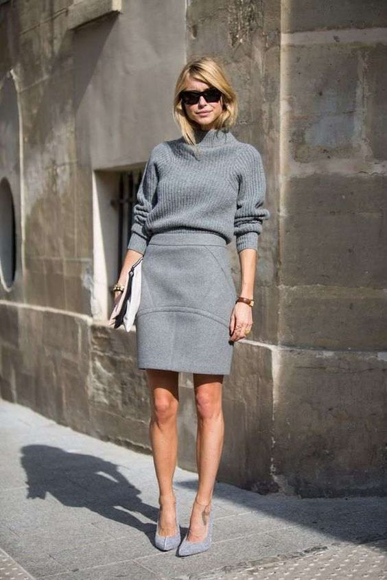 a monochromatic grey outfit with a turtleneck sweater, a structural mini skirt and shoes plus a clutch