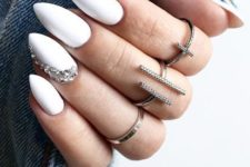 09 a refined white manicure with a single accent nail with rhinestones looks wow