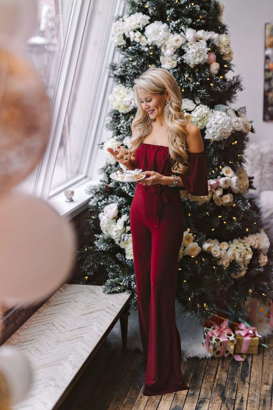 an off the shoulder burgundy jumpsuit with a ruffled neckline is a very girlish and sexy option