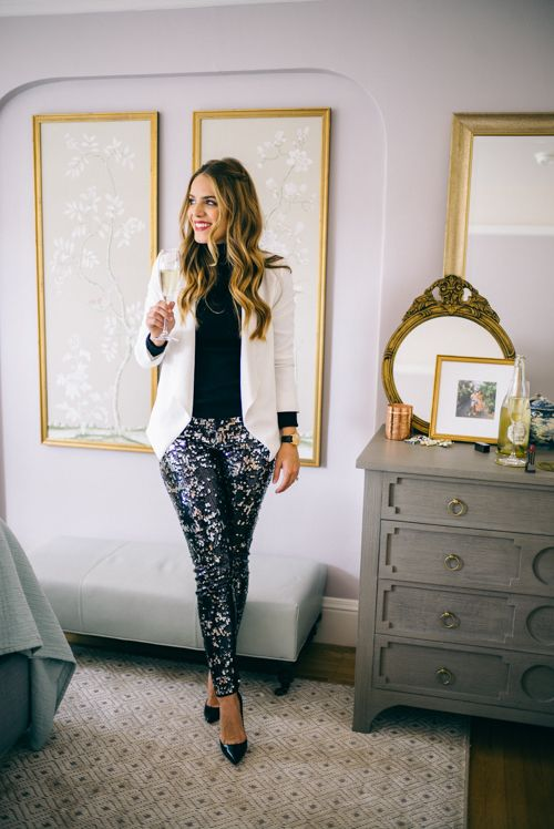 a black turtleneck, a white blazer, navy sequin pants, black lacquer shoes for an elegant look