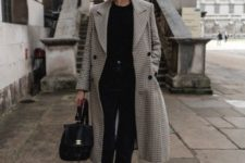 10 a chic look with a black top, black straight jeans, white sneakers, a printed coat, a black backpack