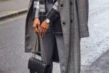 10 a layered look with a black top, a plaid blazer, grey pants, black sock boots, a black bag and a plaid coat