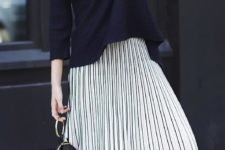 10 a navy sweater, a striped pleated midi skirt, striped sneakers and statement minimalist accessories