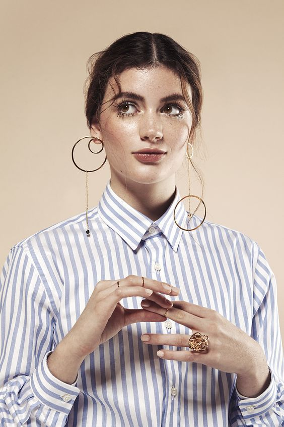 a set of mismatching minimalist earrings with cirles and beads is a stylish statement idea