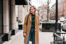 10 a vintage-infused look with a plaid sweater, blue high waisted jeans, brown hiking boots and a tan coat