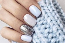 10 glossy white nails and a single sivler glitter accent one for a shiny and frosty look