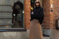 11 a black oversized sweater, tan pleated midi, black knee boots for a trendy minimal winter look