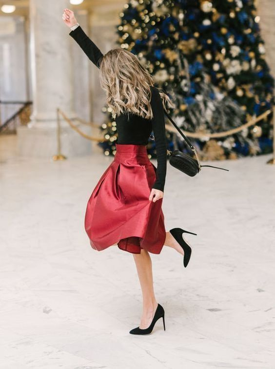 a black turtleneck, a deep red A-line skirt, black heels and a bag for a stylish Christmas outfit that requires no shopping