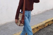 11 a cozy outfit with a burgundy sweater, blue high waisted straight jeans, white trainers and a plaid bag