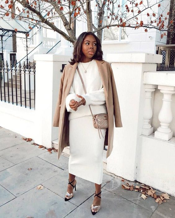 a gorgeous look with a pencil maxi skirt, a white oversized sweater, a camel coat and a bag and statement shoes