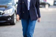 11 blue jeans, a white t-shirt, a navy manly blazer and black sock boots for a chic and modern look