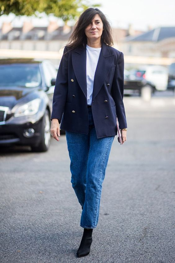blue jeans, a white t-shirt, a navy manly blazer and black sock boots for a chic and modern look