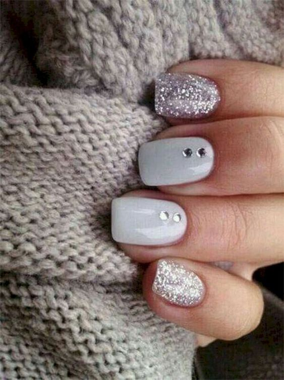 glossy white nails paired with silver glitter ones and rhinestones for a shiny winter-inspired look