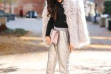 12 a holiday look with a black turtleneck, silver pants, black studded heels and a blush faux fur coat