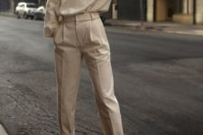 12 a neutral look with high waisted pants, a cashmere sweater and white shoes will always be to the point