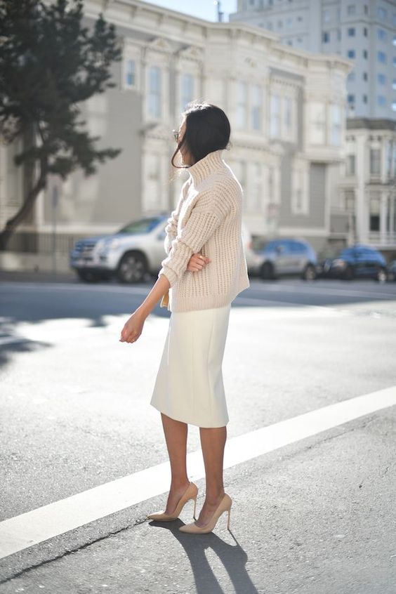an oversized creamy sweater, a white pencil skirt, nude shoes for a chic yet comfortable look