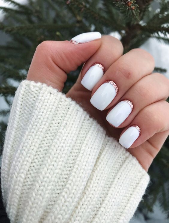 glossy white nails with rose gold glitter touches are super chic and girlish