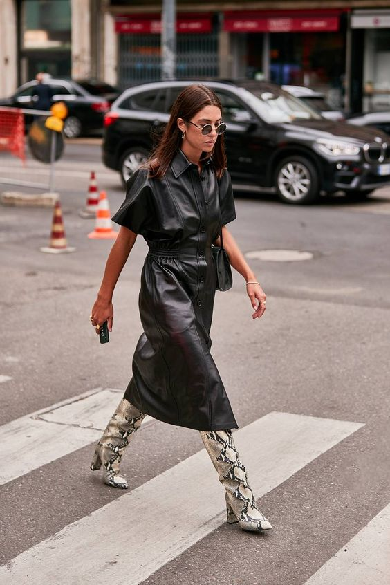a black leather midi shirtdress on buttons with short sleeves, animal print boots and a black bag