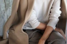 13 a neutral oversized jumper, grey pants, a camel coat for a comfortable minimalist work outfit