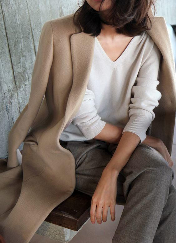 a neutral oversized jumper, grey pants, a camel coat for a comfortable minimalist work outfit
