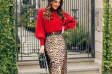 13 a red sweater, a leopard print pencil midi skirt, black shoes and a black bag for a refined feel