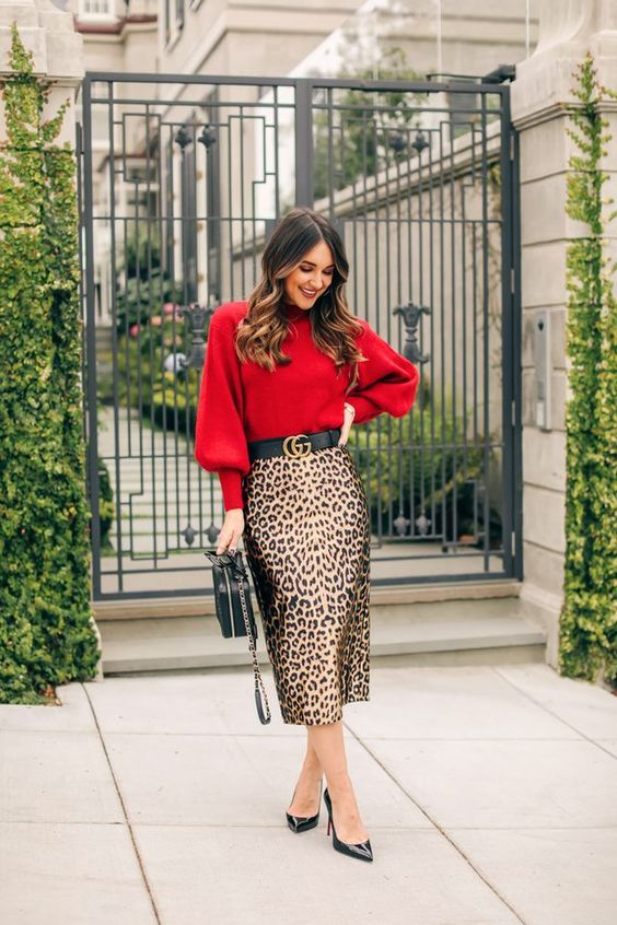 a red sweater, a leopard print pencil midi skirt, black shoes and a black bag for a refined feel