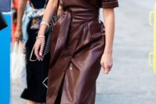 14 a burgundy wrap leather midi dress with buttons going asymmetrically and a belt plus amber boots