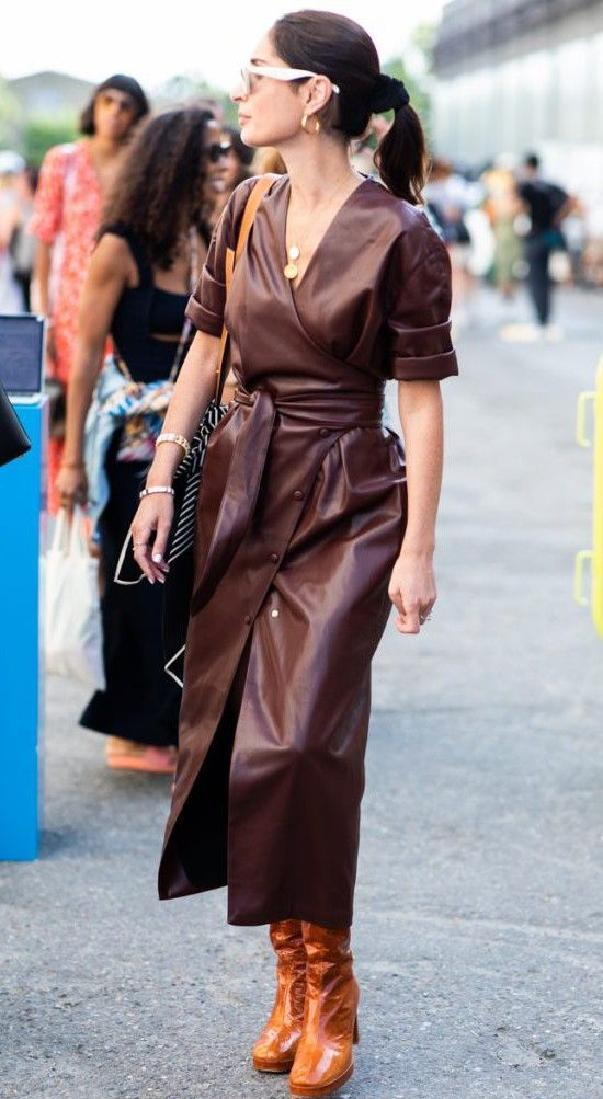 a burgundy wrap leather midi dress with buttons going asymmetrically and a belt plus amber boots