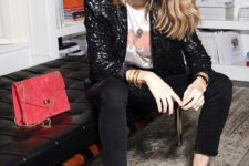 14 a printed tee, black skinnies, a black sequin blazer, red shoes and a red bag for a bright touch