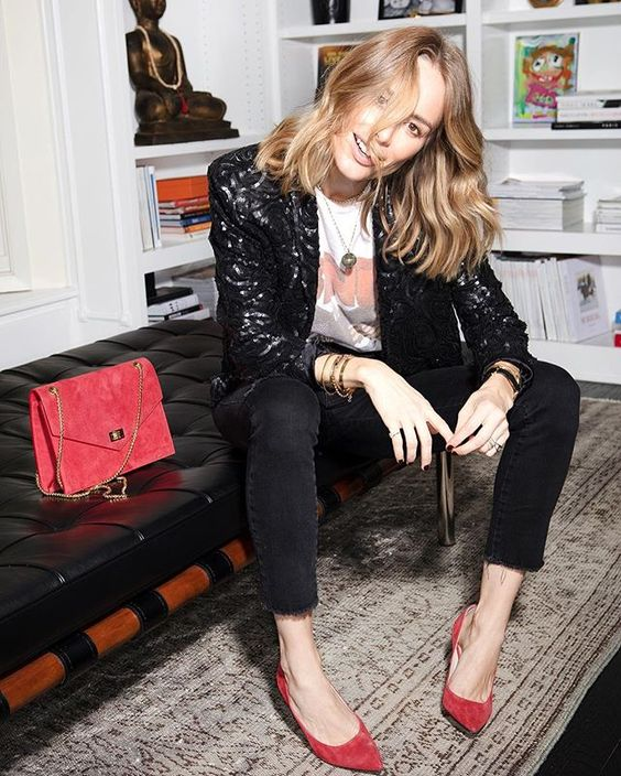 a printed tee, black skinnies, a black sequin blazer, red shoes and a red bag for a bright touch