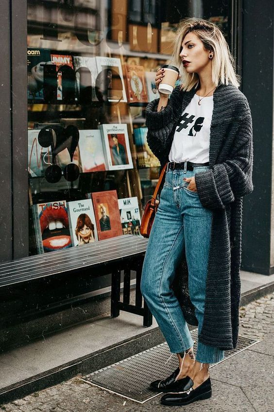 a winter look with a printed tree, blue straight jeans, black loafers and a grey chunky knit cardigan