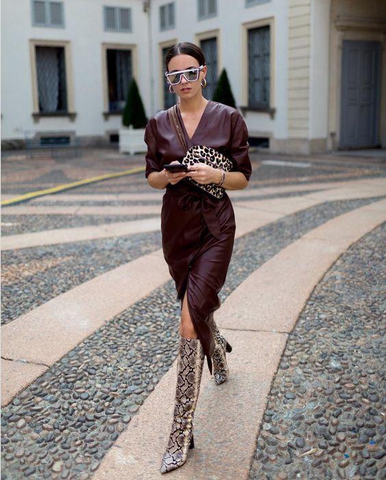 a burgundy wrap midi dress with long sleeves, an animal print bag and animal print boots